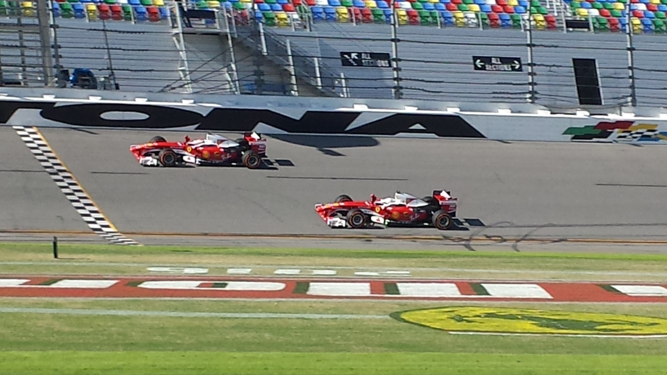 F1 drivers Kimi Räikkönen and Sebastian Vettel turn laps in F60s at Daytona International Speedway Sunday. (Photo: Greg Engle)
